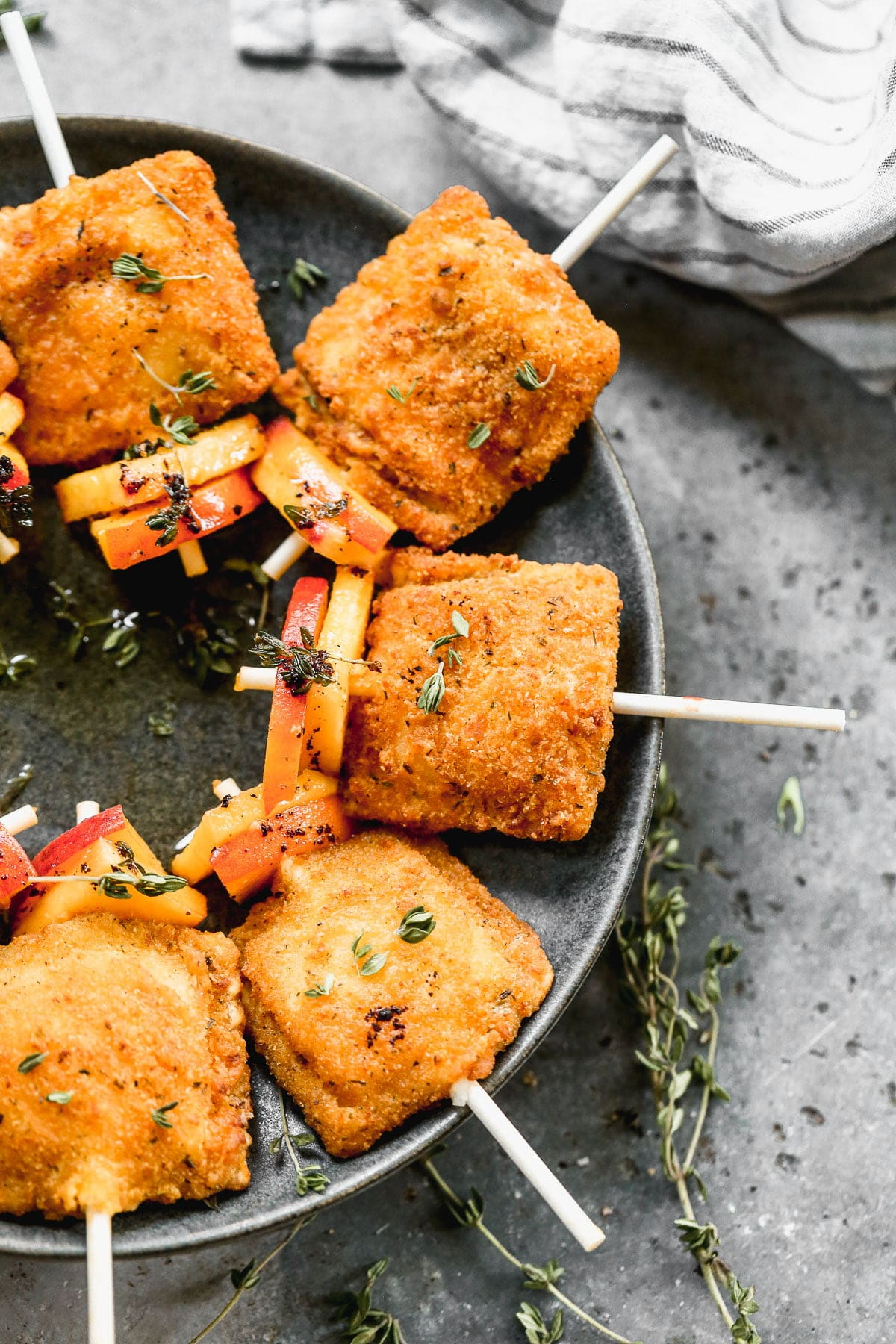 Cocktail hour just got infinitely easier and more delicious with our Peach Toasted Ravioli Pops. We throw crispy ravioli on a cocktail stick with the ripest summer peaches, drizzle each one with brown butter and thyme infused honey and serve it up with our favoirte chilled rose.