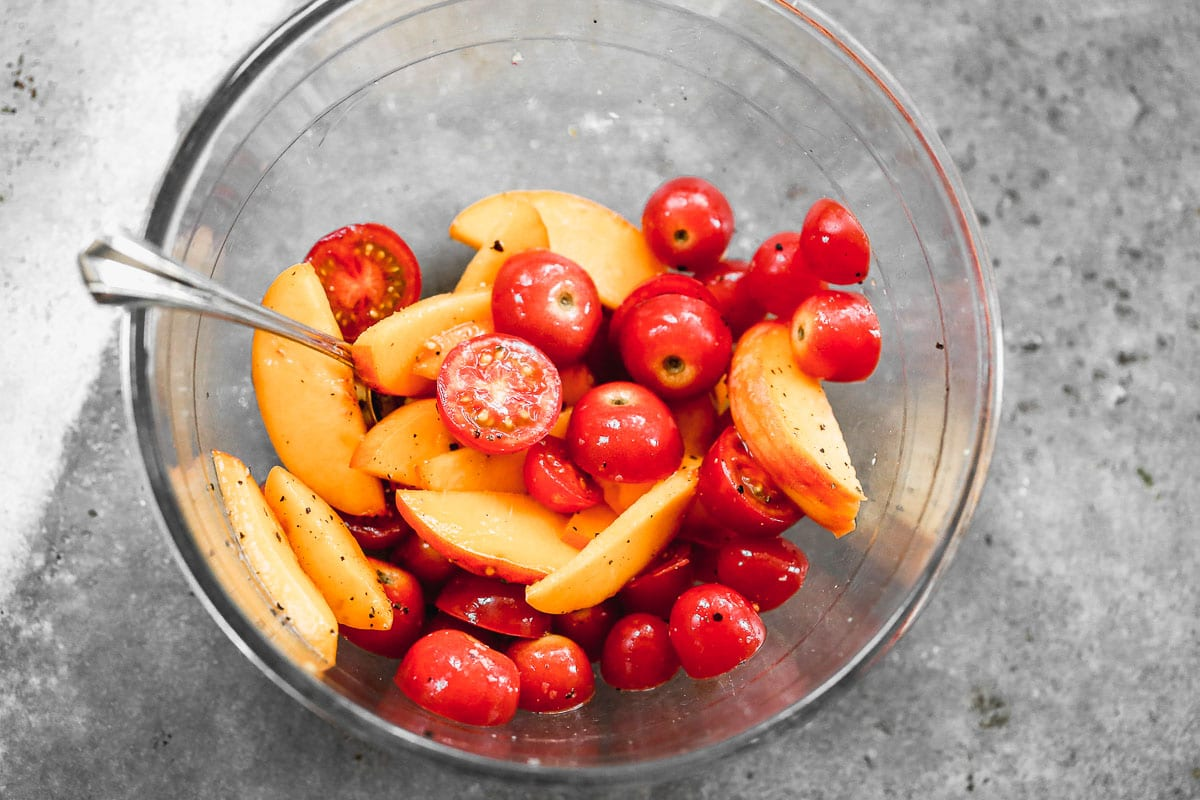 Peaches and tomatoes in a bowl