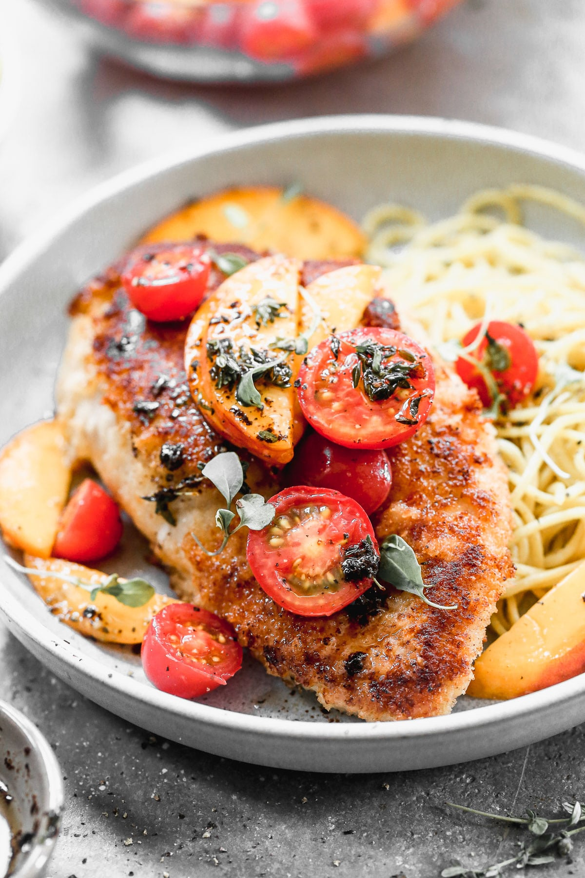 If summer were showcased on a plate it would surely be in the form of our Mozzarella-Stuffed Peach Chicken. This ultra crispy on the exterior, cheesy and tender on the interior winner of a chicken dish is adorned with the sweetest peaches and tomatoes and then drizzled with an intoxicating combination of brown butter, thyme, and lemon.You don't want to miss it!