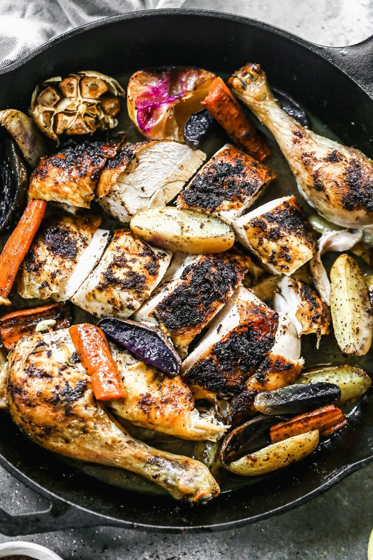 With a crispy sumac and garlic crusted skin and a juicy lemon-kissed interior, our Cast Iron Roast Chicken is not only perfectly delicious but the perfect fall dinner. Alongside the chicken, we scatter fingerling potatoes and whole carrots to sop up every bit of salty juice that drips to the bottom of the pan.