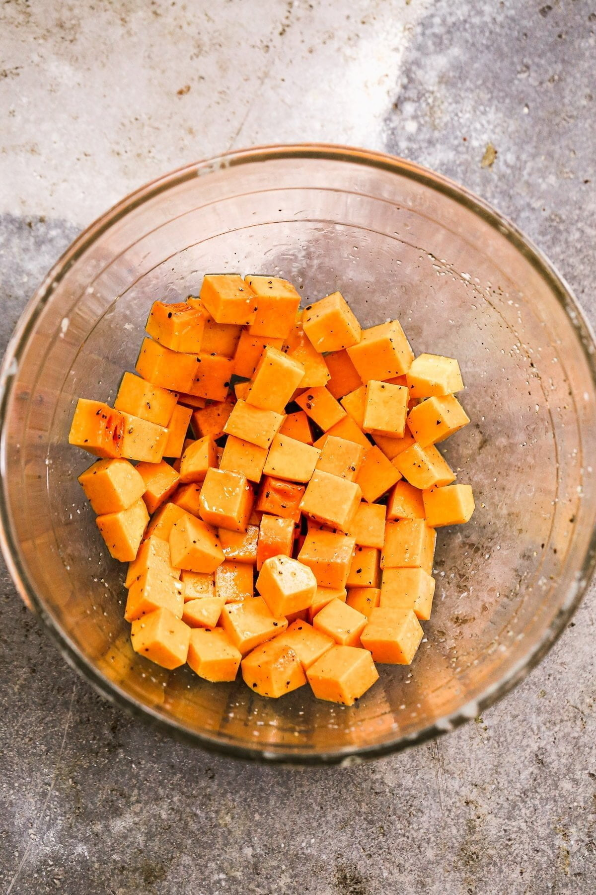 Diced butternut squash tossed in olive oil, salt and pepper